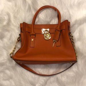 Orange Michael Kors Hamilton purse.